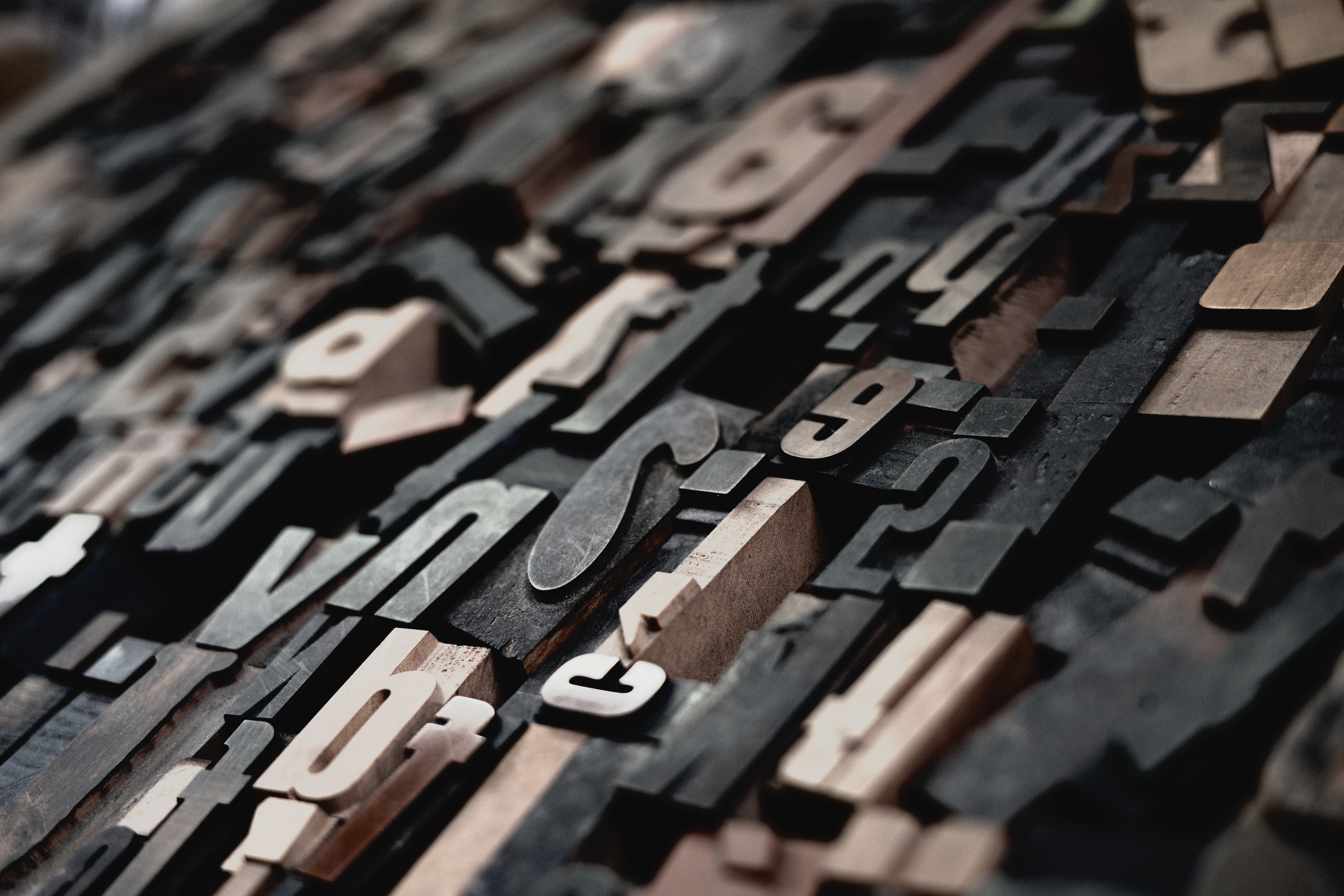 close up of wooden letters for a printing press