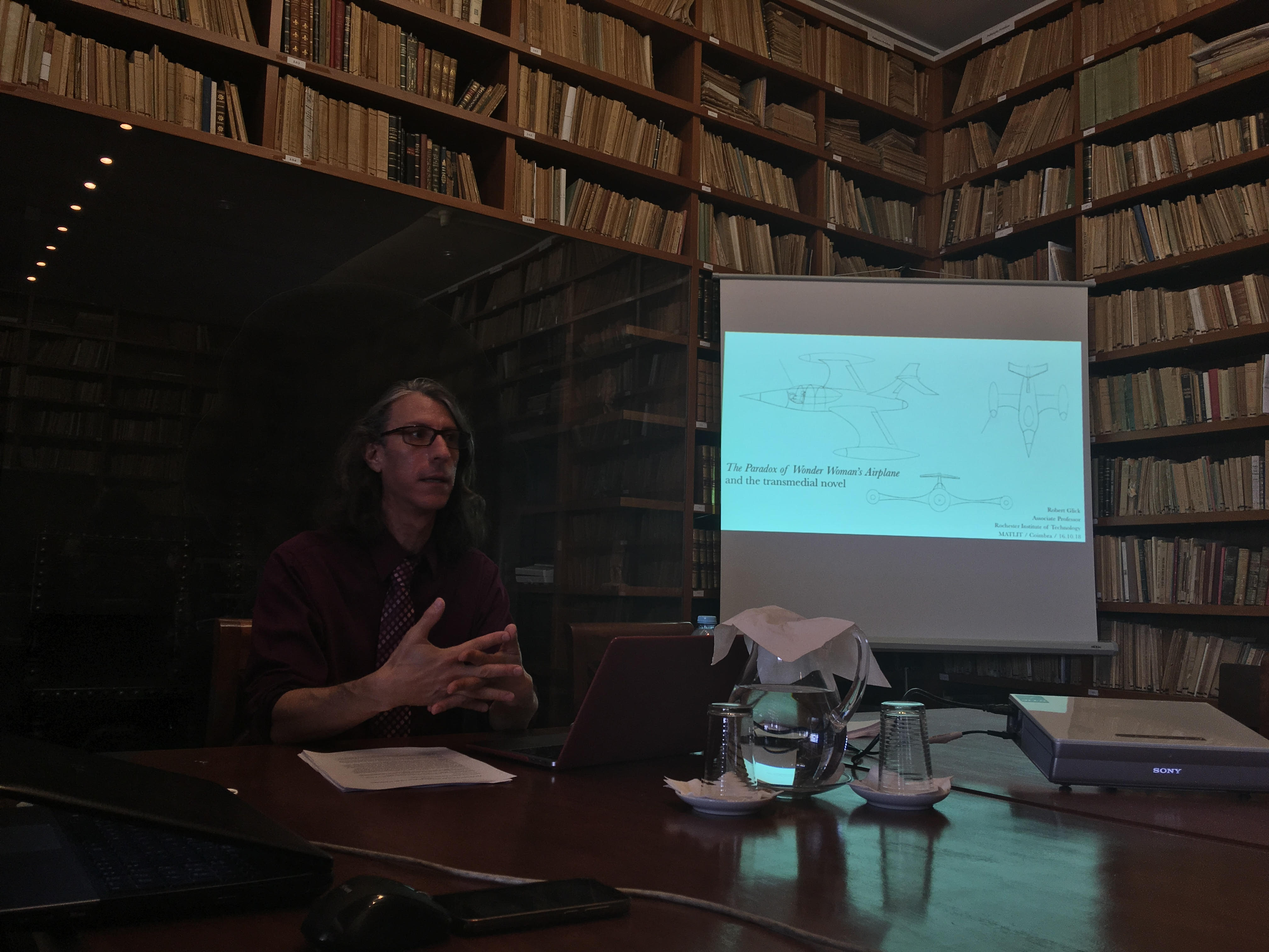 photo of Robert lecturing in a library